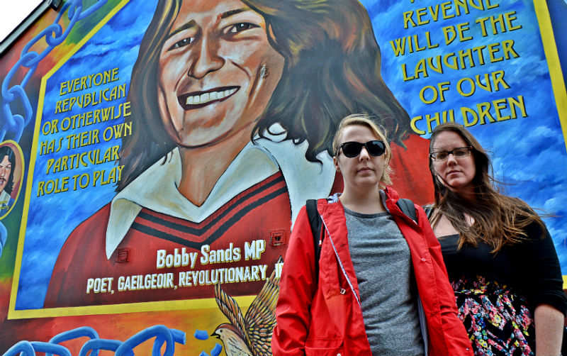 Eileen and Megan in front of Bobby Sands mural in Belfast, Northern Ireland